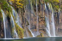 Waterfalls on lake Galovac in autumn, National Park Plitvice Lakes, Croatia