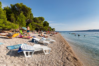 People relaxing and swimming on the famous beach Punta Rata in place Brela, Dalmatia, Croatia